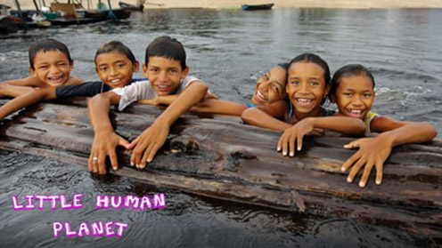 Children in water resting on a wooden log