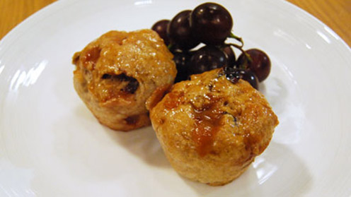 Two fruit and fudge buns with grapes