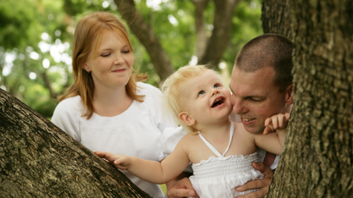 Man, woman and girl in tree