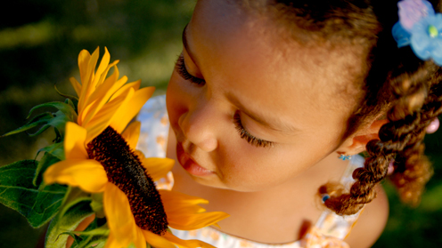Little girl and sunflower