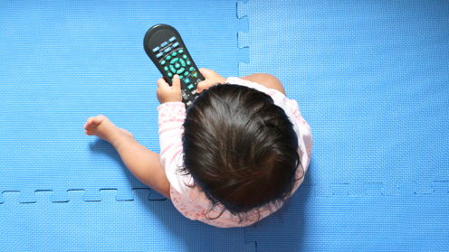 toddler with remote control