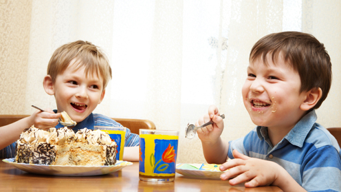 Children eating cake