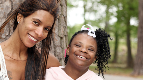 Child and woman smiling