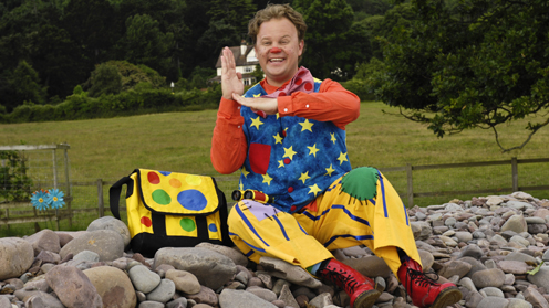 Mr Tumble signing Makaton with his spotty bag