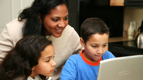 Mother, two children and laptop