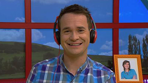 CBeebies Presenter Alex with headphones on