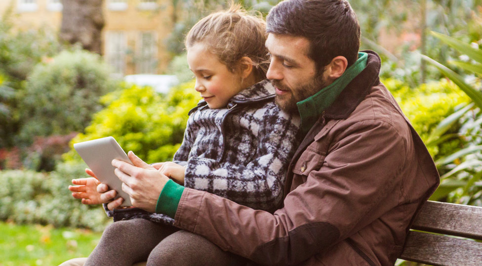 Father and child with tablet