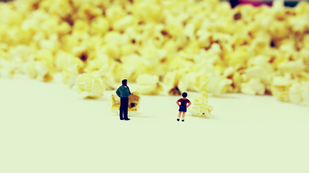 Little people with popcorn