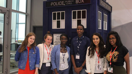 Six students on the BBC Outreach Summer Work Experience scheme posing in front of the TARDIS