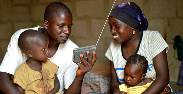 A family in northern Nigeria listen to a radio.